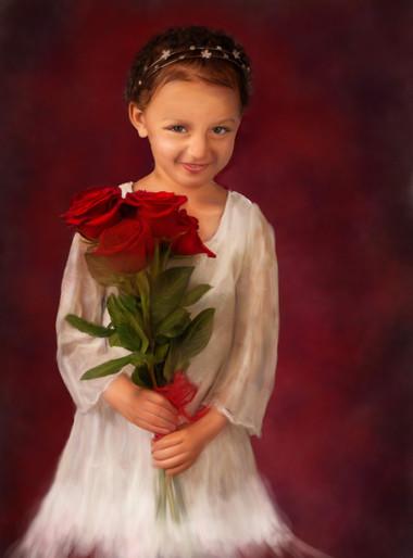 Little Girl holding red roses