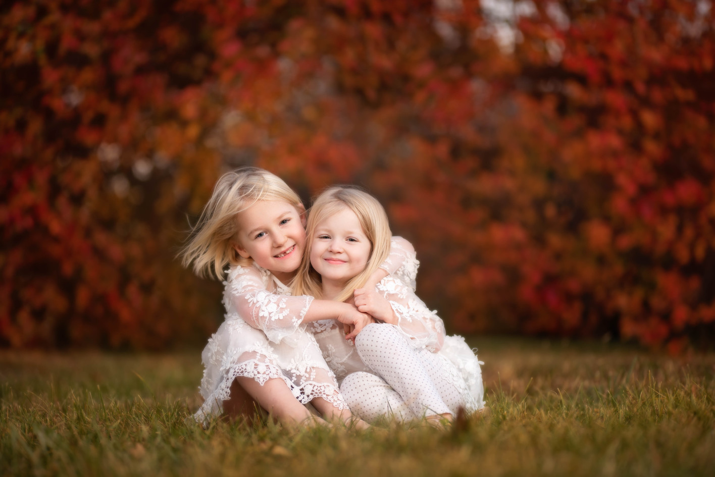 Sisters Snuggling in Fall