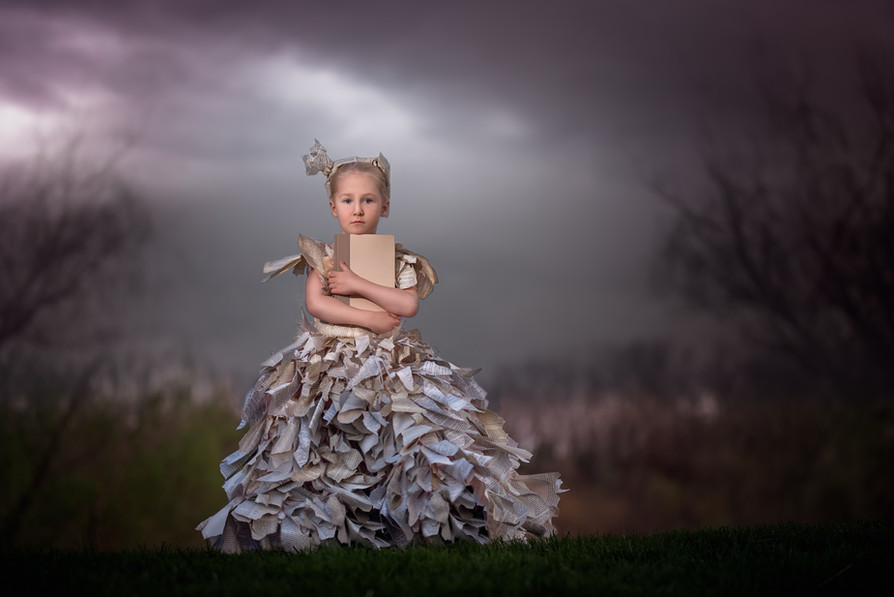 Spooky child photography with a dress made of books