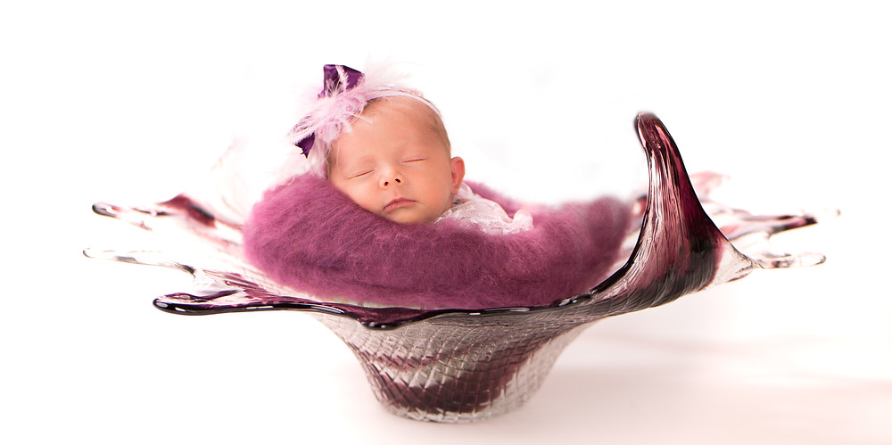 Beautiful felted layer with baby in a blown glass art bowl