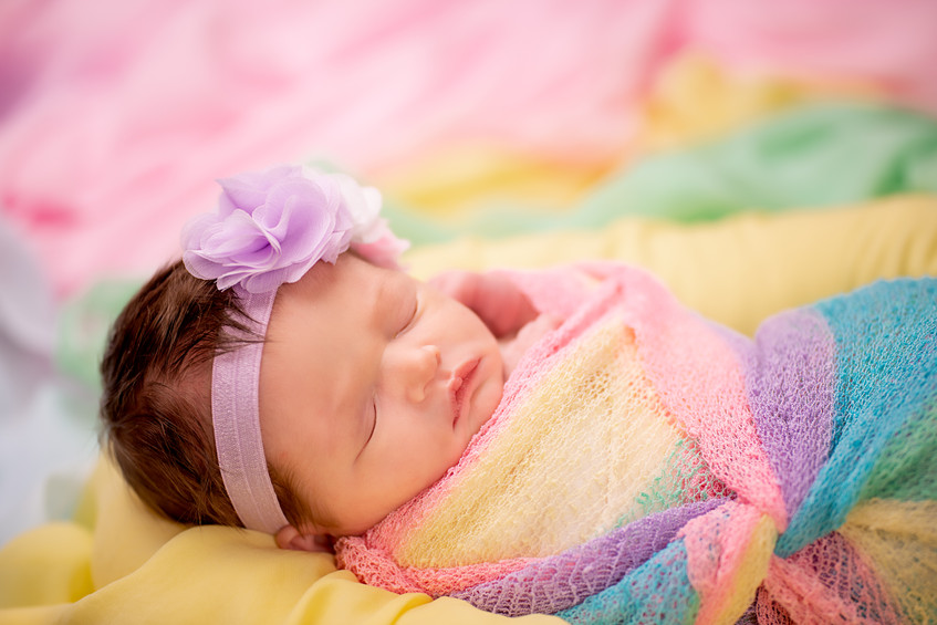 Beautiful rainbow baby newborn photography for miracle babies in Overland Park