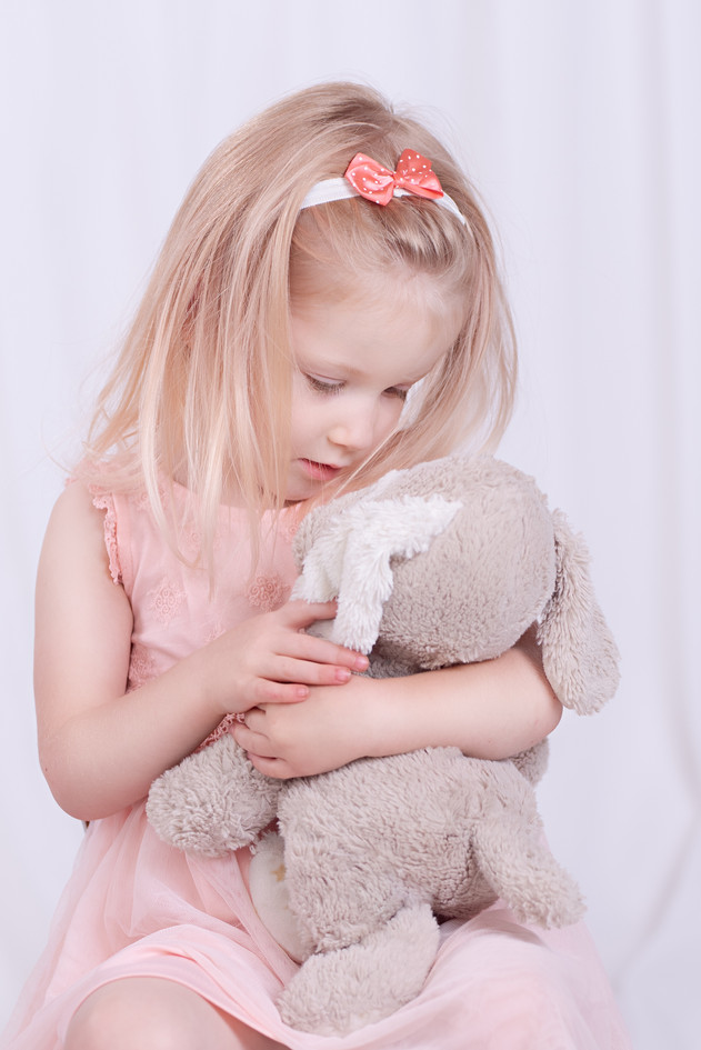The innocence of childhood by snuggling a bear