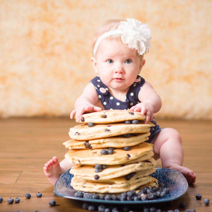 Baby in Lenexa eating big food