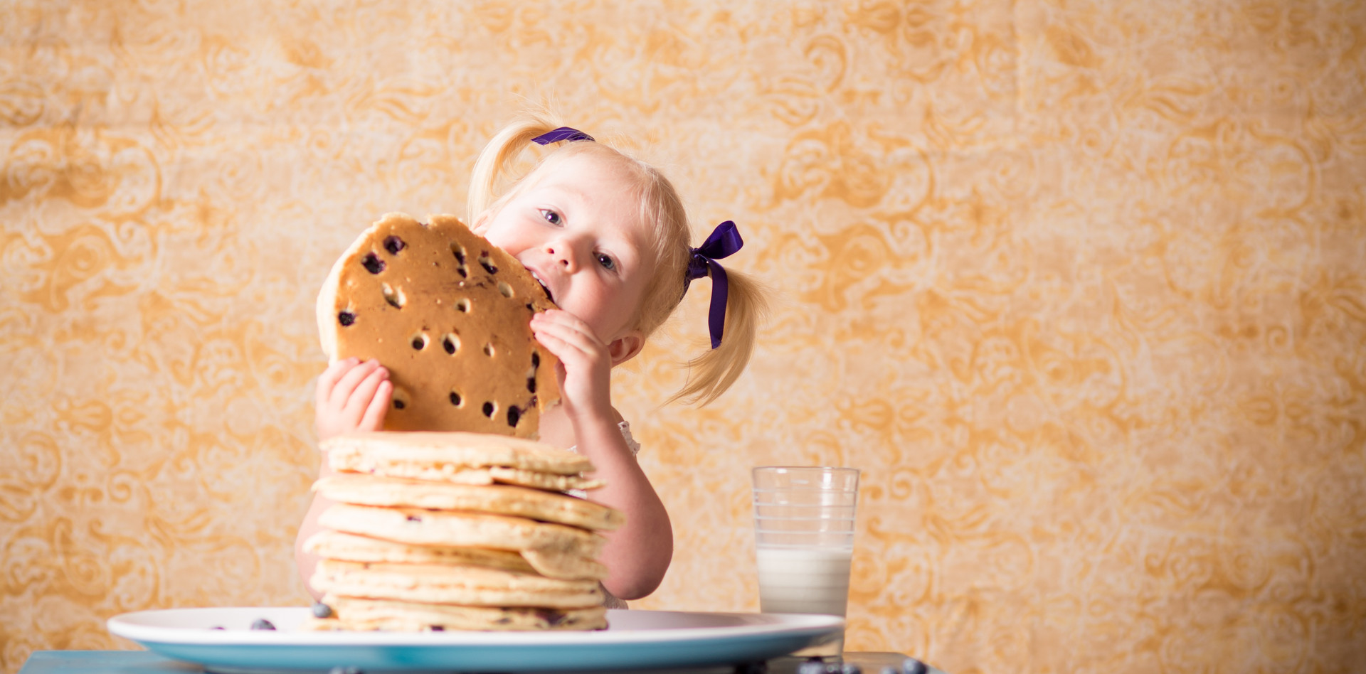 Child with huge pancakes