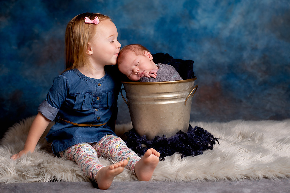 Best Overland Park newborn photographer does sibling newborn photos with toddler