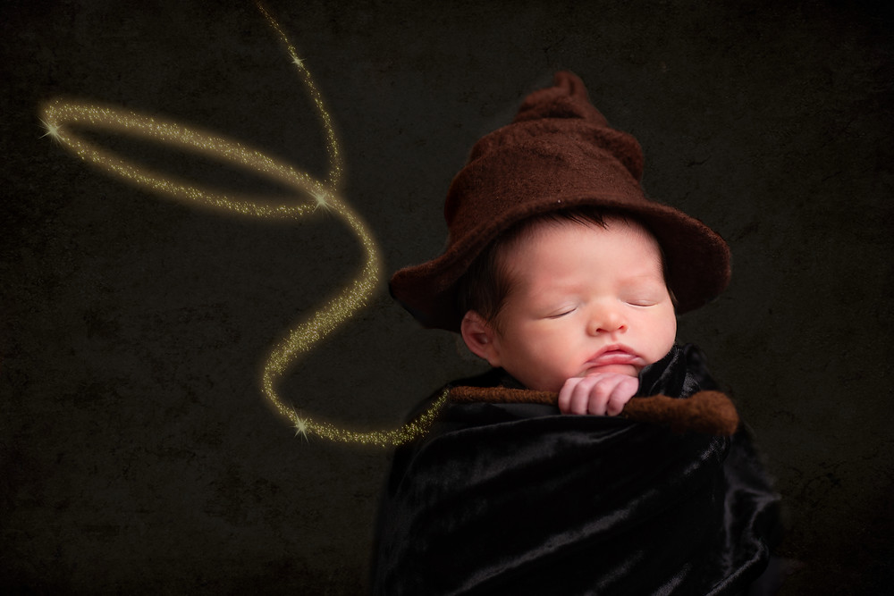 Harry Potter Newborn Photography with Hat and Wand by best Overland Park newborn photographer