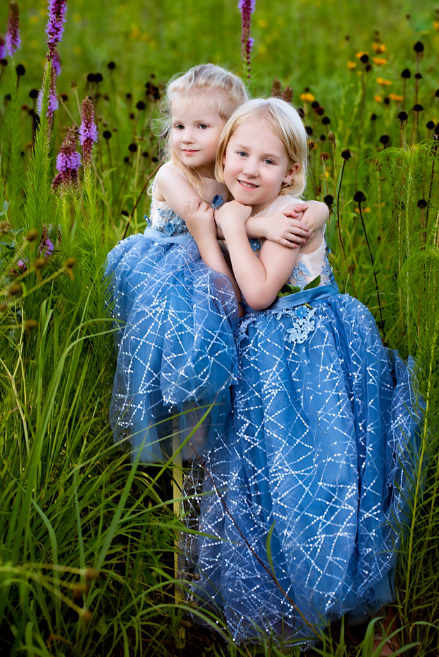 Sisters hugging in a flower field