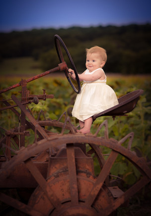 Baby driving tractor