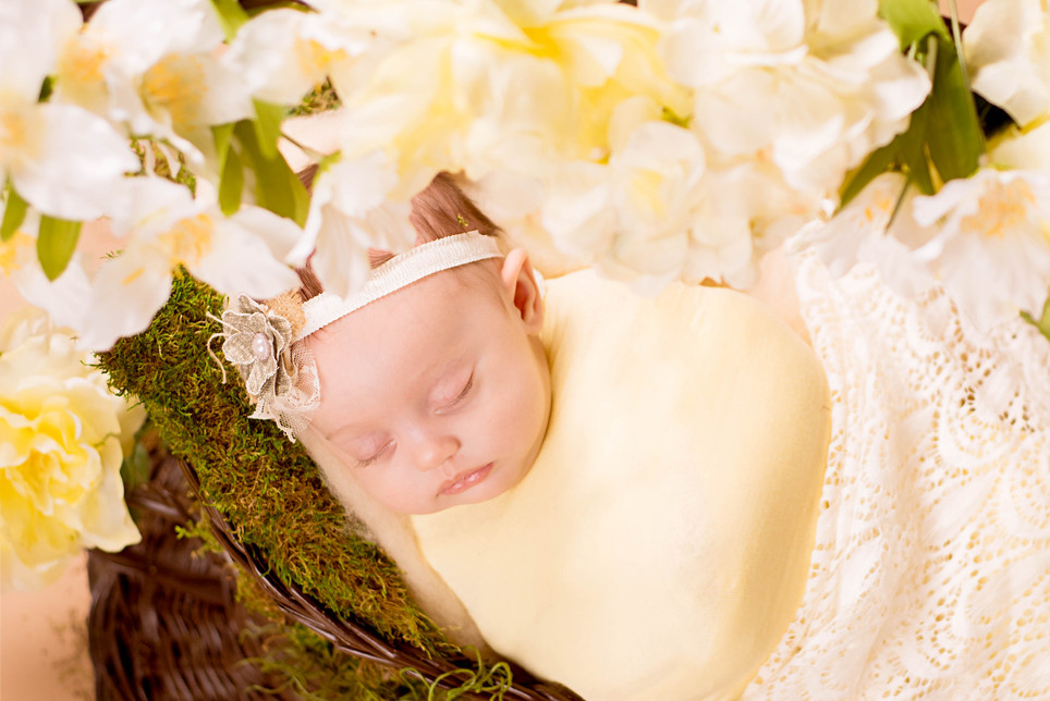 Newborn with yellow flowers