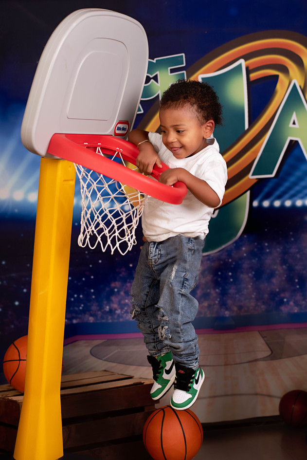 Toddler Dunking a Basketball