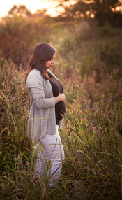 Glowing pregnant woman in nature