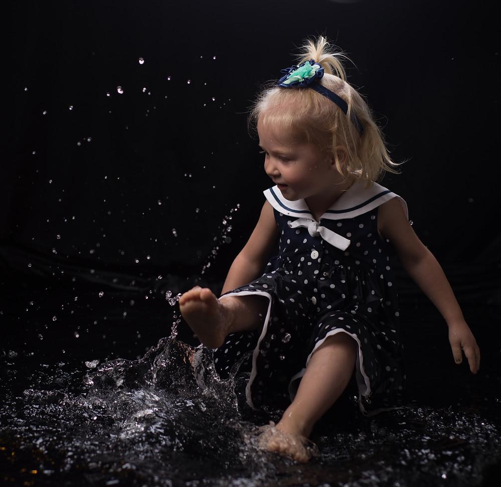 Reflecting Pool Picture with Splashing Child on black backdrop in Lenexa