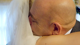 Father of te Bride hugs his daughter