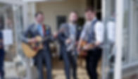groom and best man perform with Alex Birtwell