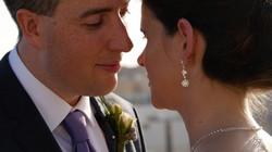 bride & groom look lovingly