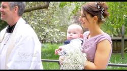 bridesmaid holding baby at church