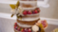 Stunning naked wdding cake decorated with strawberries