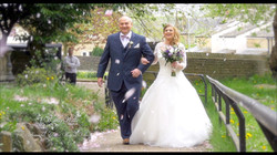 Bride and father in blossom shower