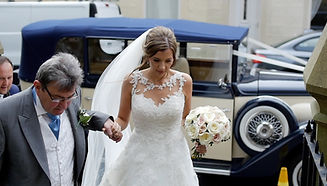 bride and her father arrive at church for wedding