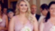 Bridesmaid smiles during wedding ceremony