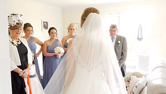 Bride reveals her wedding dress to the wedding party
