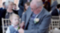 Father of the Groom and Groom's son wear buttonholes