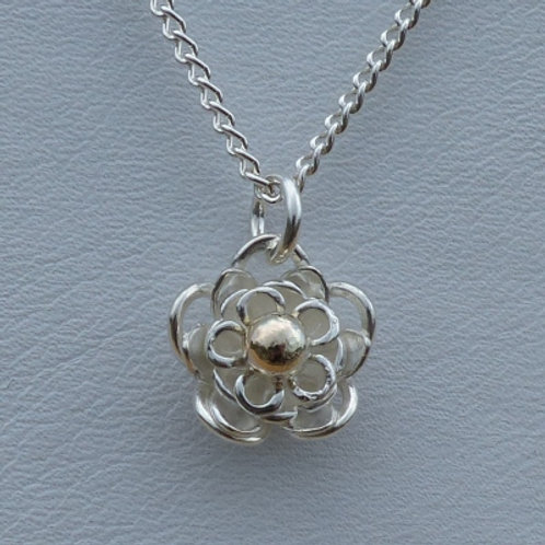 Silver Flower Pendant with a centre of 9ct Gold