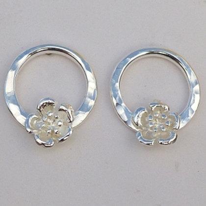 Silver circular hammered daisy studs