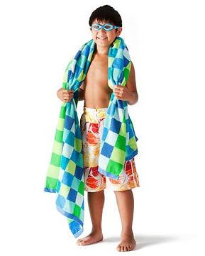 ymca aquatics boy with towel over should