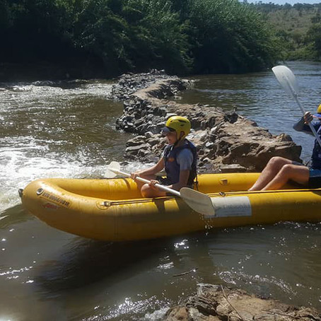 RIVER RAFTING WITH RAPIDESCENT ADVENTURES