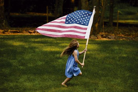 Young Girl Waving American Flag