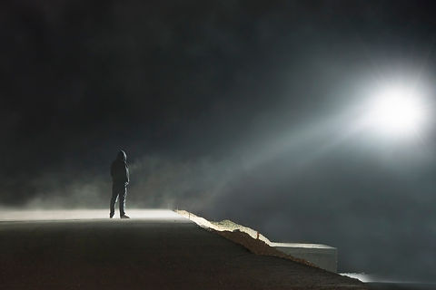 A lone hooded figure standing on a spook