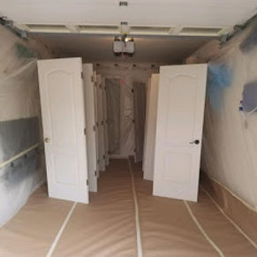 This garage is being used as a spray booth to spray paint doors. A interior painting project.