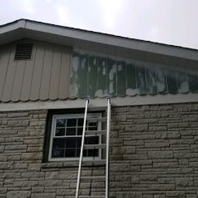 Exterior wood siding that is being painted.