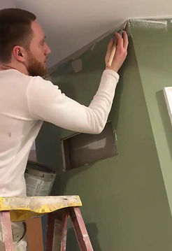 Painter at Benji's Painting. Interior painting in Lititz PA. Owner Benjamin Duffy painting interior walls in Lititz PA.