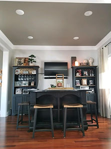 A interior painted dining room that has a grey ceiling, grey walls and hardwood floors. A interior paintig project.