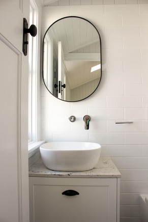 bathroom sink with oval mirror