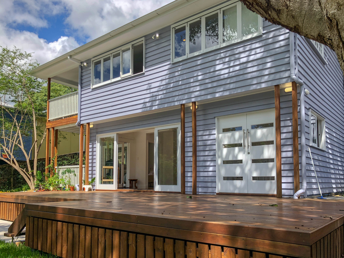 timber decking of grey two storey home