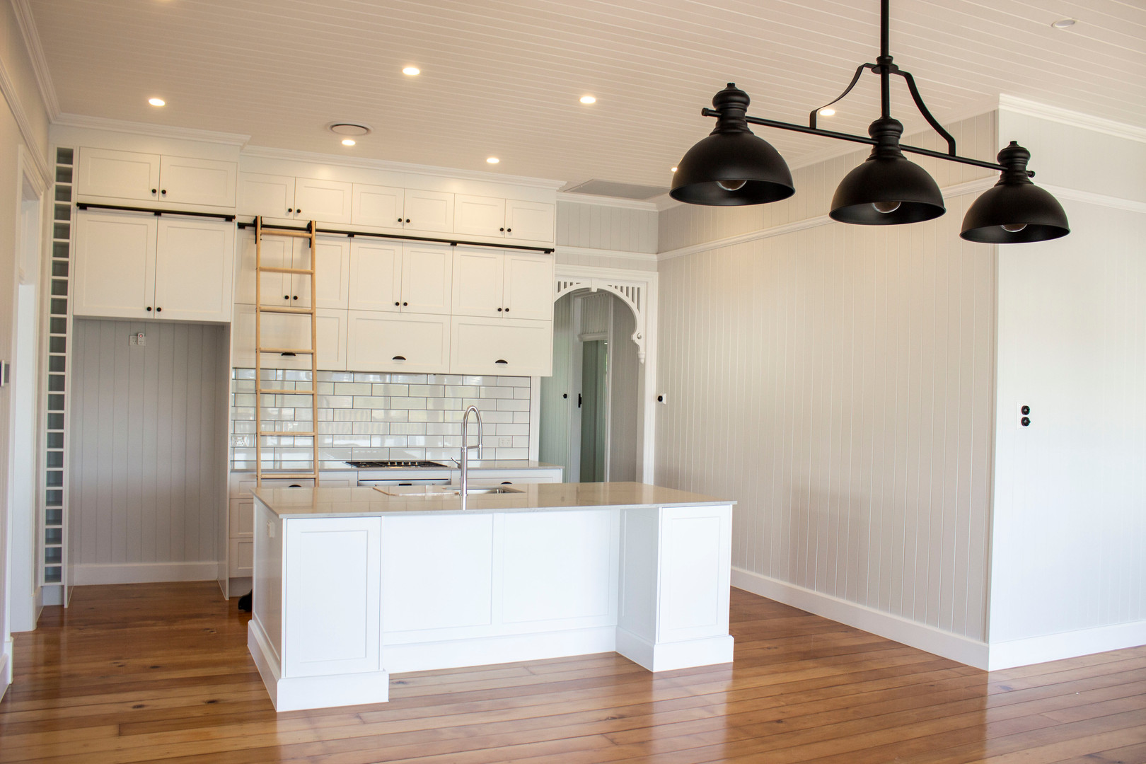open kitchen with black lights, island b