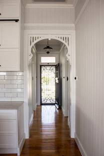 hallway with detailed cornices