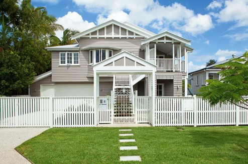 front of heritage home with grey tones,