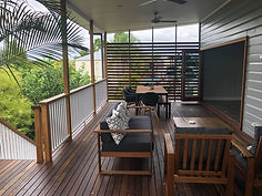 large timber deck with timber outdoor fu