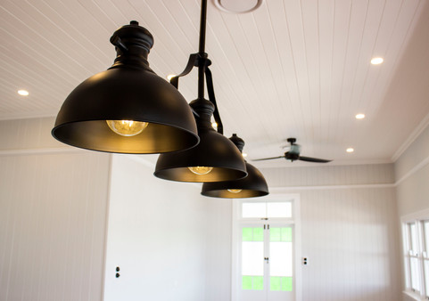 three black pendent lights