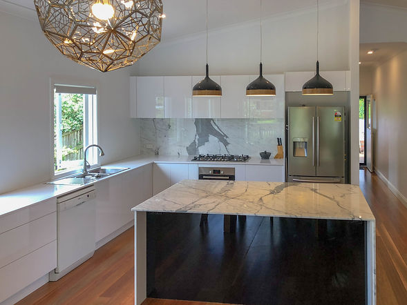 kitchen with marbled island and white be