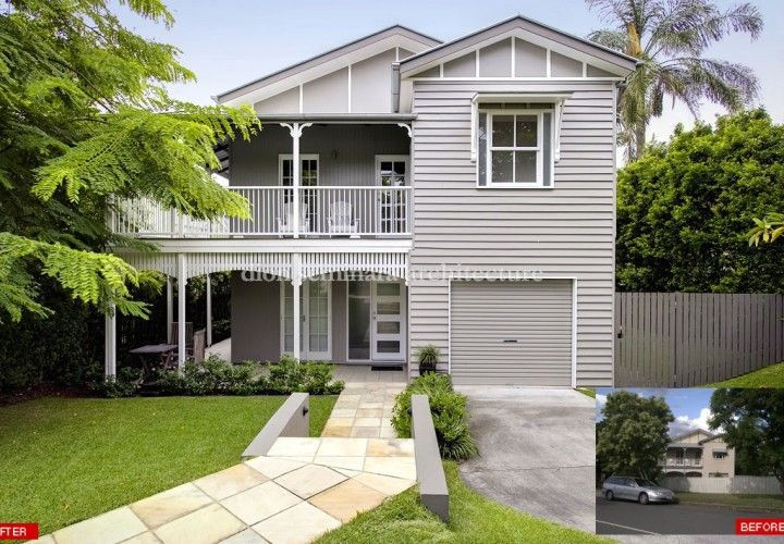 two storey grey heritage home and paved