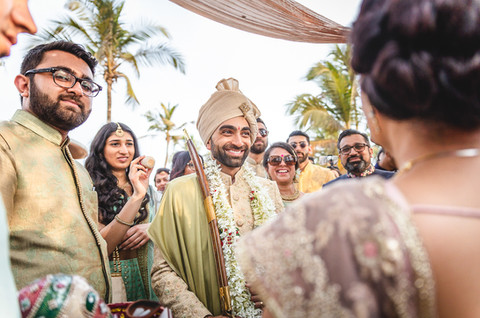 Welcoming the groom ritual at Goa wedding