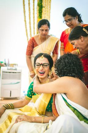 Tying the thali at Indian wedding. Bride laughing