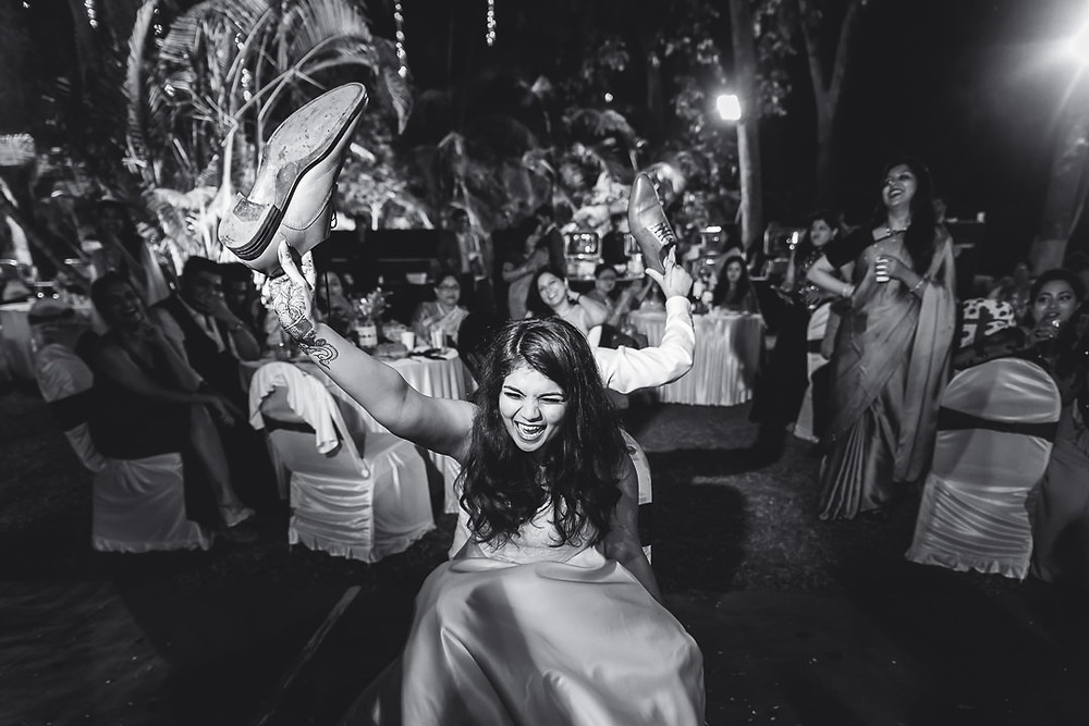 Bride and groom playing the shoe game at their reception in India