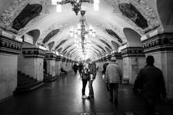 Couple saying goodbye in the middle of a metro station in moscow