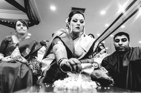american bride performing indian wedding ritual